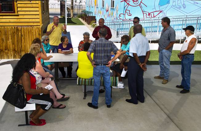 Attendees meet at the Learning Village during a planned gathering of concerned neighbors about the current noise and possibility of more downtown development on Thursday, May 15, 2014. Unfortunately no city representatives showed up stating meeting time had been changed to later in the day.