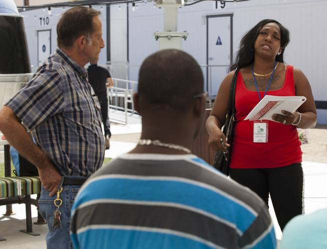 Terry Hooks speaks at the Learning Village during a planned gathering of concerned neighbors about the current noise and possibility of more downtown development on Thursday, May 15, 2014.