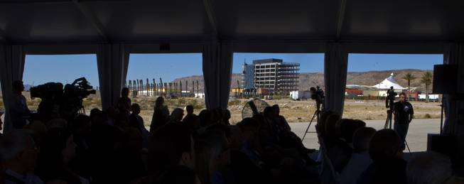 "Attendees to the Downtown Summerlin media ""hard hat"" tour of the project listen to a progress report by developers before seeing for themselves on Thursday, May 15, 2014."
