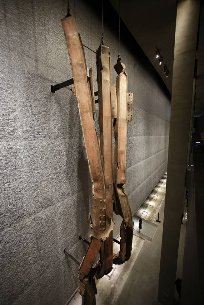 A section of steel facade, from floors 96-99 of the north tower of the World Trade Center, is displayed at the National Sept. 11 Memorial Museum, Wednesday, May 14, 2014, in New York. The museum is a monument to how the Sept. 11 terror attacks shaped history, from its heart-wrenching artifacts to the underground space that houses them amid the remnants of the fallen twin towers' foundations. It also reflects the complexity of crafting a public understanding of the terrorist attacks and reconceiving ground zero.  (AP Photo)