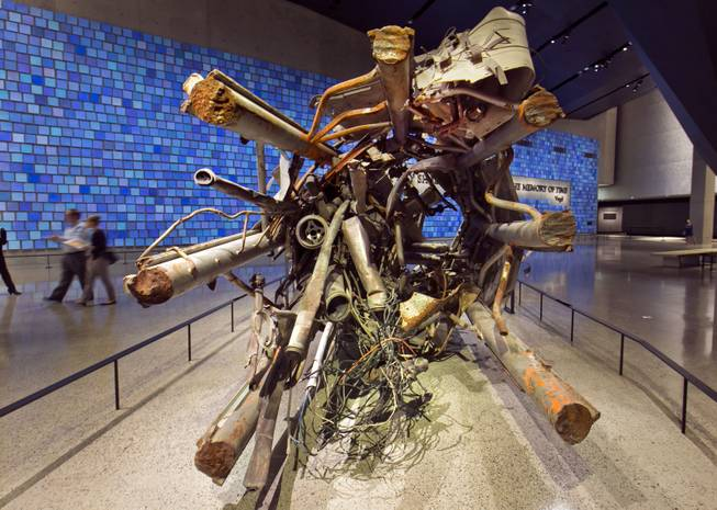 The twisted remains of a portion of the television transmission tower from the World Trade Center is displayed at the National Sept. 11 Memorial Museum, Wednesday, May 14, 2014, in New York. The museum is a monument to how the Sept. 11 terror attacks shaped history, from its heart-wrenching artifacts to the underground space that houses them amid the remnants of the fallen twin towers' foundations. It also reflects the complexity of crafting a public understanding of the terrorist attacks and reconceiving ground zero.  (AP Photo)