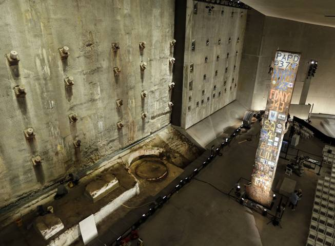 A portion of the World Trade Center slurry wall, left, and the symbolic last beam, are displayed at the National Sept. 11 Memorial Museum, Wednesday, May 14, 2014, in New York. The museum is a monument to how the Sept. 11 terror attacks shaped history, from its heart-wrenching artifacts to the underground space that houses them amid the remnants of the fallen twin towers' foundations. It also reflects the complexity of crafting a public understanding of the terrorist attacks and reconceiving ground zero.  (AP Photo)