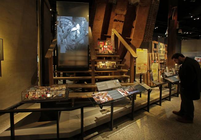 The Family Viewing Platform, and memorabilia from the World Trade Center, are displayed at the National Sept. 11 Memorial Museum, Wednesday, May 14, 2014, in New York. The museum is a monument to how the Sept. 11 terror attacks shaped history, from its heart-wrenching artifacts to the underground space that houses them amid the remnants of the fallen twin towers' foundations. It also reflects the complexity of crafting a public understanding of the terrorist attacks and reconceiving ground zero.  (AP Photo)