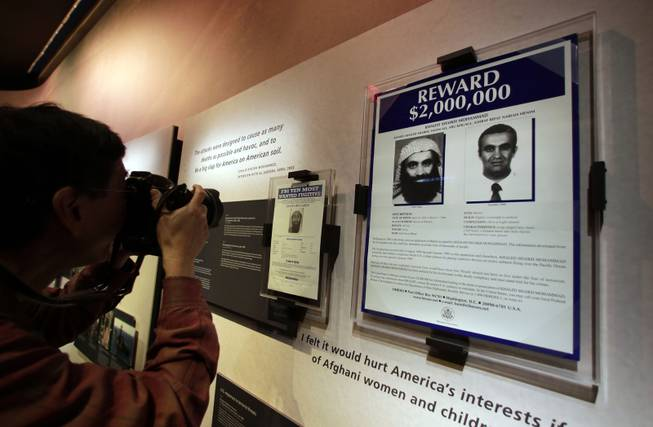 The wanted posters of Osama Bin Laden, left, and Khaled Shaikh Mohammad are displayed at the National Sept. 11 Memorial Museum, Wednesday, May 14, 2014, in New York. The museum is a monument to how the Sept. 11 terror attacks shaped history, from its heart-wrenching artifacts to the underground space that houses them amid the remnants of the fallen twin towers' foundations. It also reflects the complexity of crafting a public understanding of the terrorist attacks and reconceiving ground zero.  (AP Photo)