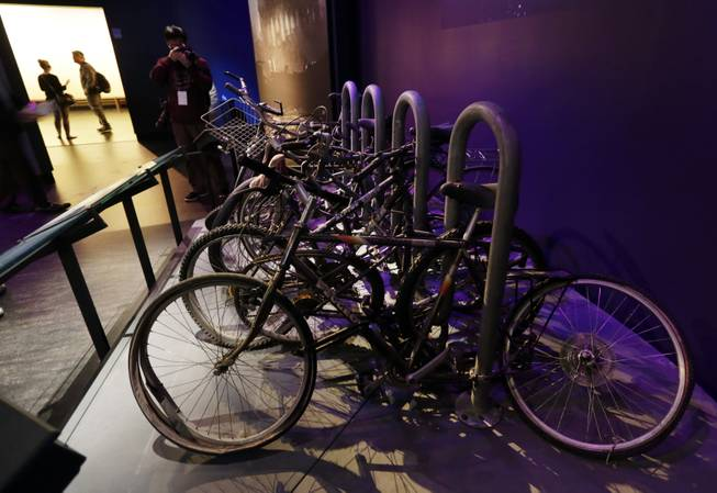 A salvaged bicycle rack, that was located on the northern edge of the World Trade Center site, is displayed at the National Sept. 11 Memorial Museum, Wednesday, May 14, 2014, in New York. The museum is a monument to how the Sept. 11 terror attacks shaped history, from its heart-wrenching artifacts to the underground space that houses them amid the remnants of the fallen twin towers' foundations. It also reflects the complexity of crafting a public understanding of the terrorist attacks and reconceiving ground zero.  (AP Photo)