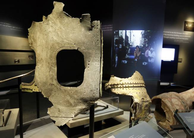 Fragments of the fuselage of Flight 11, that hit the World Trader Center, are displayed at the National Sept. 11 Memorial Museum, Wednesday, May 14, 2014, in New York. The museum is a monument to how the Sept. 11 terror attacks shaped history, from its heart-wrenching artifacts to the underground space that houses them amid the remnants of the fallen twin towers' foundations. It also reflects the complexity of crafting a public understanding of the terrorist attacks and reconceiving ground zero.  (AP Photo)
