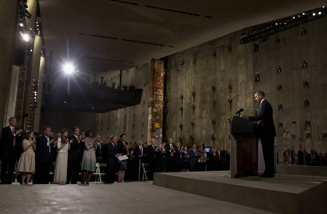 President Barack Obama speaks at the National September 11 Memorial Museum, Thursday, May 15, 2014, in New York. Speaking at the dedication, the president said, no act of terror can match the strength and character of the United States.   (AP Photo/Carolyn Kaster)
