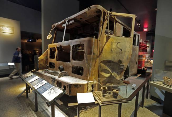 The remains of New York City Fire Dept. truck from Engine Company 21 are displayed at the National Sept. 11 Memorial Museum, Wednesday, May 14, 2014, in New York. The museum is a monument to how the Sept. 11 terror attacks shaped history, from its heart-wrenching artifacts to the underground space that houses them amid the remnants of the fallen twin towers' foundations. It also reflects the complexity of crafting a public understanding of the terrorist attacks and reconceiving ground zero.  (AP Photo)