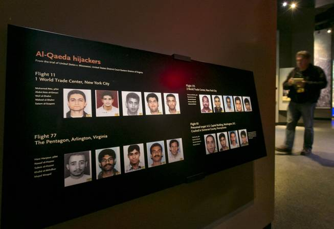 Portraits of the Al-Qaeda hijackers are displayed at the National Sept. 11 Memorial Museum, Wednesday, May 14, 2014, in New York. The museum is a monument to how the Sept. 11 terror attacks shaped history, from its heart-wrenching artifacts to the underground space that houses them amid the remnants of the fallen twin towers' foundations. It also reflects the complexity of crafting a public understanding of the terrorist attacks and reconceiving ground zero.  (AP Photo)