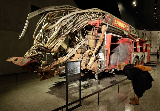 The remains of Fire Dept. of New York Ladder Company 3's truck are displayed at the National Sept. 11 Memorial Museum, Wednesday, May 14, 2014, in New York. The museum is a monument to how the Sept. 11 terror attacks shaped history, from its heart-wrenching artifacts to the underground space that houses them amid the remnants of the fallen twin towers' foundations. It also reflects the complexity of crafting a public understanding of the terrorist attacks and reconceiving ground zero.  (AP Photo)