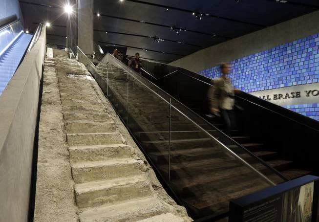 "The ""Survivor Stairs,"" left, from The World Trader Center, are displayed at the National Sept. 11 Memorial Museum, Wednesday, May 14, 2014, in New York. The museum is a monument to how the Sept. 11 terror attacks shaped history, from its heart-wrenching artifacts to the underground space that houses them amid the remnants of the fallen twin towers' foundations. It also reflects the complexity of crafting a public understanding of the terrorist attacks and reconceiving ground zero.  (AP Photo)"