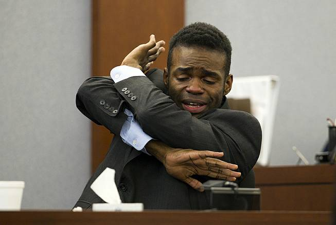 Defendant Jason Omar Griffith describes a struggle with his ex-girlfriend as he testifies in his own defense during his trial at the Regional Justice Center in Las Vegas Thursday, May 15, 2014.