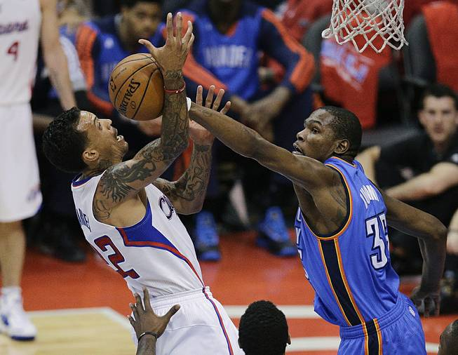 Los Angeles Clippers' Matt Barnes, left, gets his shot blocked by Oklahoma City Thunder's Kevin Durant during the second half in Game 6 of the NBA Western Conference semi-finals on Thursday, May 15, 2014, in Los Angeles.