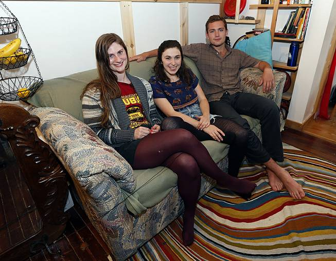 Lara Russo, Cally Guasti and Reese Werkhoven sit on a couch in their apartment in New Paltz, N.Y., on Thursday, May 15, 2014. The roommates had purchased it at a Salvation Army store and found $40,800 stashed inside.