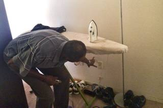 Herman Jackson Jr., a 14 year resident of the Buena Vista Springs complex, points at a broken emergency pull cord alarm system in his apartment Thusday, May 15, 2014.