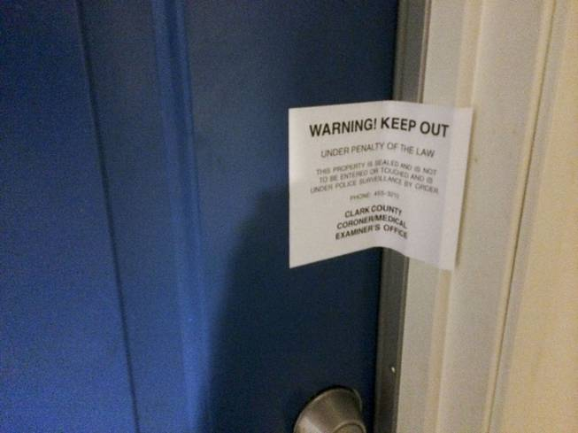 A warning sign from the coroner's office prohibits people from entering an apartment at the Buena Vista Springs complex Thursday, May 15, 2014.