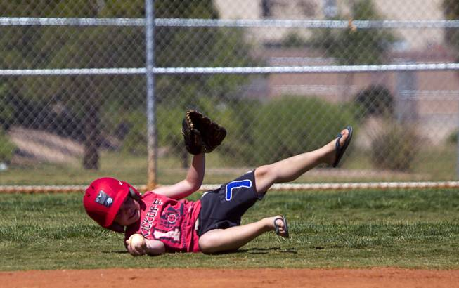Sinjin McCrady, 5, fields a ball during a casual Sunday baseball game at Red Ridge Park May 11, 2014.