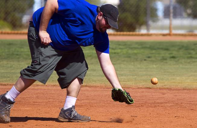 Vinny Greco of Winder Farms misses a grounder during a casual Sunday baseball game at Red Ridge Park May 11, 2014.