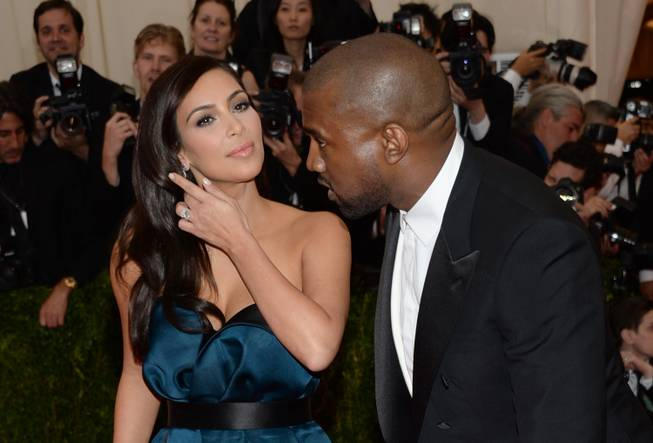 "Kim Kardashian and Kanye West attend the Metropolitan Museum of Art's Costume Institute benefit gala celebrating ""Charles James: Beyond Fashion"" on Monday, May 5, 2014, in New York."