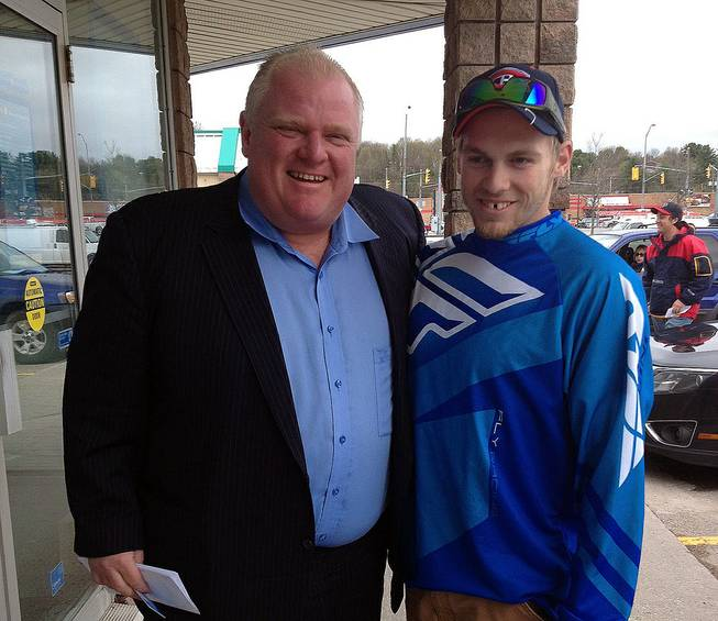 In this photo provided by Brody Lisle, Toronto Mayor Rob Ford poses for a photo with him in Bracebridge, Ontario, Canada on Friday, May 16, 2014.