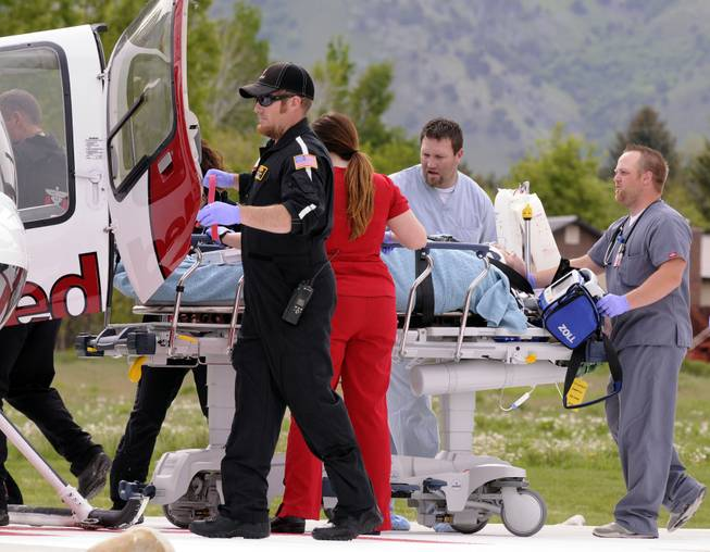 Jason Burr is loaded into an AirMed helicopter to be transported to another hospital after he entered the Cache Valley Hospital with a gun and was shot by law enforcement, Friday, May 16, 2014, in North Logan, Utah.