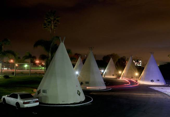 "The Wigwam Motel still attracts tourists to its teepee-shaped rooms along ""America's Highway,"" Route 66 in San Bernardino, Calif. As the number of tourists attracted by the historic roadway dwindle, merchants along the route must find new ways to attract visitors."