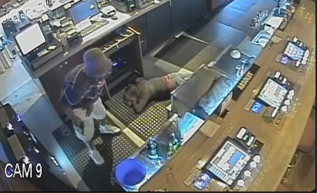 Henderson Police released this surveillance photo from an armed robbery May 4 at a Wildfire Casino in Henderson. Police are seeking clues to the identity of the man, who forced an employee to the floor at gunpoint while robbing the casino.