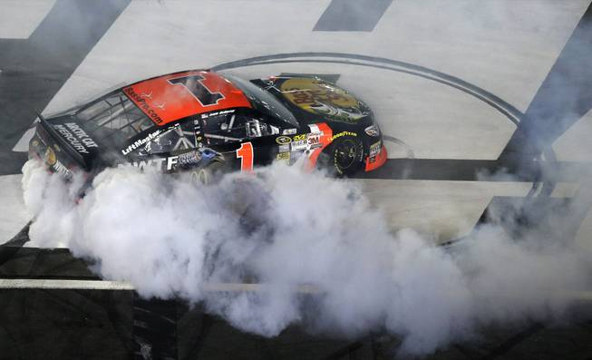 Jamie McMurray does a burnout after his victory in the NASCAR Sprint All-Star race at Charlotte Motor Speedway in Concord, N.C., on Saturday, May 17, 2014.