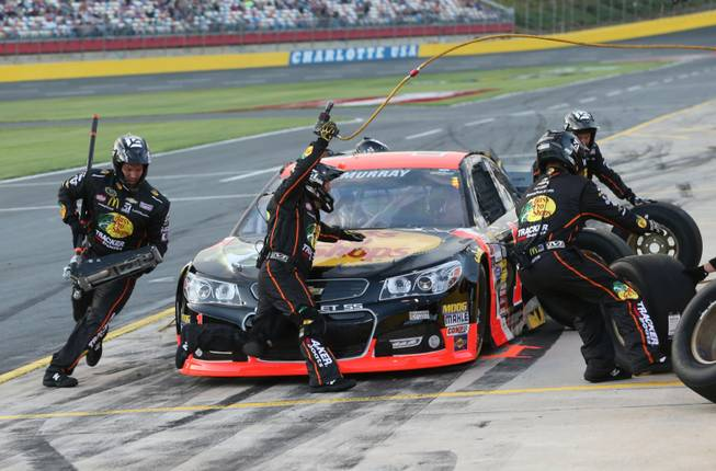 Crew members perform a pit stop on driver Jamie McMurray's car during qualifying for the NASCAR Sprint All-Star race at Charlotte Motor Speedway in Concord, N.C., on Saturday, May 17, 2014.