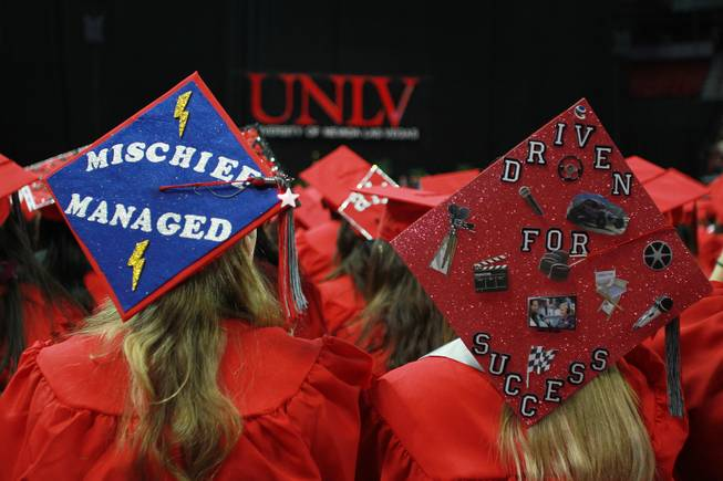 UNLV students display decorated mortar boards during commencement ceremonies Saturday, May 17, 2014.