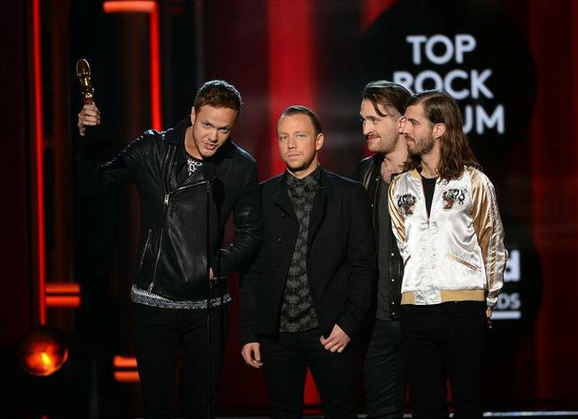 Las Vegas band Imagine Dragons accept their Top Rock Album award during the 2014 Billboard Music Awards at MGM Grand Garden Arena on Sunday, May 18, 2014.