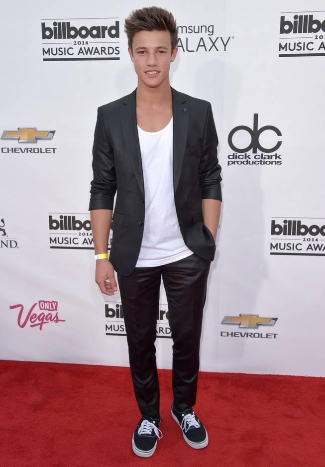 Cameron Dallas arrives at the 2014 Billboard Music Awards at MGM Grand Garden Arena on Sunday, May 18, 2014, in Las Vegas.