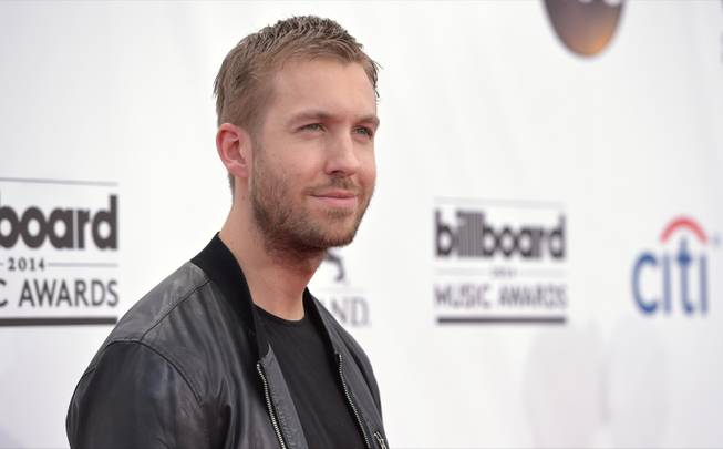 Calvin Harris arrives at the 2014 Billboard Music Awards at MGM Grand Garden Arena on Sunday, May 18, 2014, in Las Vegas.