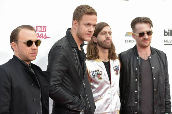 Ben McKee, Dan Reynolds, Wayne Sermon and Daniel Platzman of Imagine Dragons arrive at the 2014 Billboard Music Awards at MGM Grand Garden Arena on Sunday, May 18, 2014.