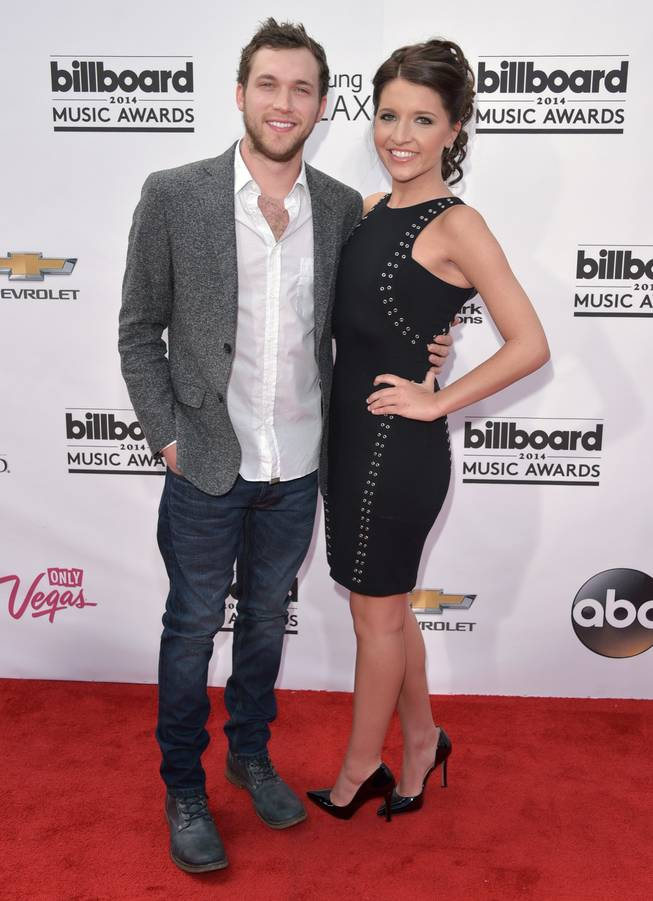Phillip Phillips and Hannah Blackwell arrive at the 2014 Billboard Music Awards at MGM Grand Garden Arena on Sunday, May 18, 2014, in Las Vegas.