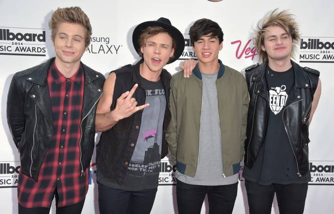 Luke Hemmings, Ashton Irwin, Calum Hood and Michael Clifford of the Australian boy band 5 Seconds of Summer arrive at the 2014 Billboard Music Awards at MGM Grand Garden Arena on Sunday, May 18, 2014, in Las Vegas.