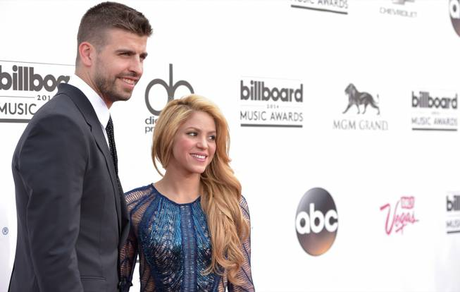 Gerard Pique and Shakira arrive at the 2014 Billboard Music Awards at MGM Grand Garden Arena on Sunday, May 18, 2014, in Las Vegas.