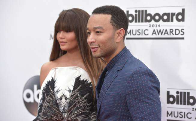 Chrissy Teigen and John Legend arrive at the 2014 Billboard Music Awards at MGM Grand Garden Arena on Sunday, May 18, 2014, in Las Vegas.