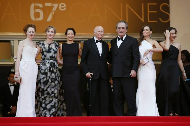 "From second right, actress Hilary Swank; director Tommy Lee Jones; Cannes film festival President Gilles Jacob; the wife of Tommy Lee Jones, Dawn Laurel-Jones; actress Sonja Richter; and actress Miranda Otto stand at the top of the red carpet as they arrive for the screening of ""The Homesman"" at the 67th international film festival in Cannes, southern France, on Sunday, May 18, 2014."