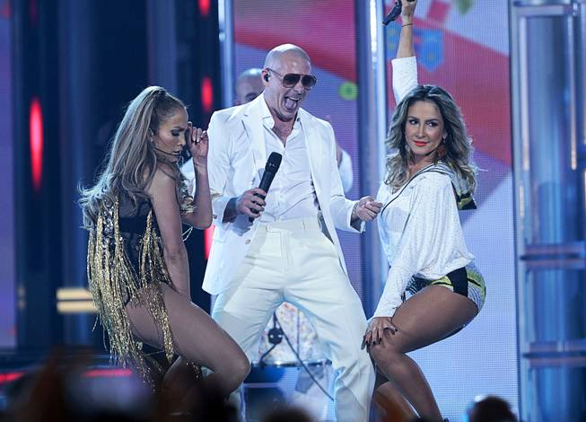 Jennifer Lopez, left, Pitbull, and Brazilian singer Claudia Leitte perform during the 2014 Billboard Music Awards at the MGM Grand Garden Arena Sunday, May 18, 2014.