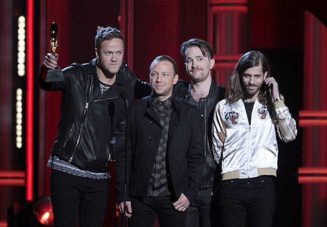 "Dan Reynolds, Ben McKee, Daniel Platzman and Wayne Sermon of Las Vegas band Imagine Dragons accept the Top Rock Album award for ""Night Visions"" during the 2014 Billboard Music Awards at MGM Grand Garden Arena on Sunday, May 18, 2014."