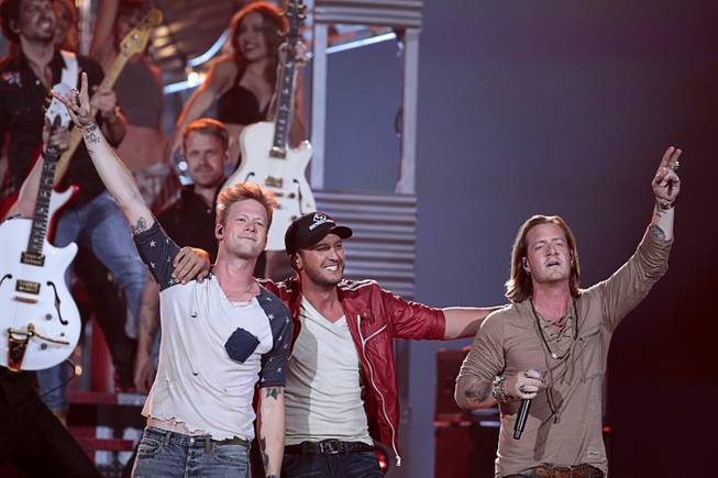 Recording artist Luke Bryan, center, and Florida Georgia Line members Brian Kelley, left, and Tyler Hubbard perform during the 2014 Billboard Music Awards at the MGM Grand Garden Arena Sunday, May 18, 2014.