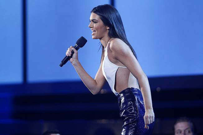 Model and reality TV star Kendall Jenner introduces 5 Seconds of Summer during the 2014 Billboard Music Awards at the MGM Grand Garden Arena Sunday, May 18, 2014.
