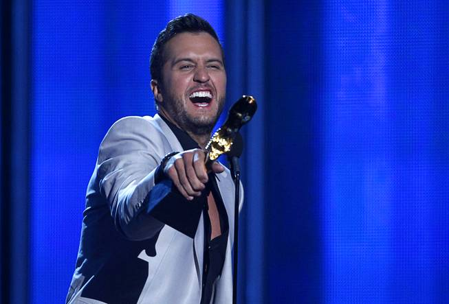 Luke Bryan accepts the award for Top Country Artist during the 2014 Billboard Music Awards at the MGM Grand Garden Arena Sunday, May 18, 2014.