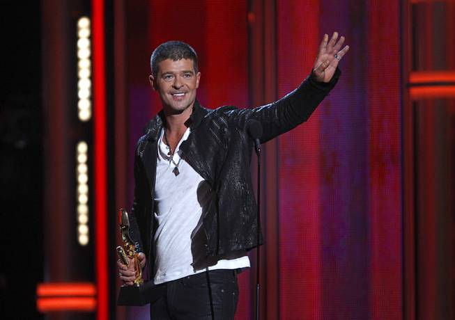 "Robin Thicke accepts the Top R&B Song award for ""Blurred Lines"" during the 2014 Billboard Music Awards at MGM Grand Garden Arena on Sunday, May 18, 2014."