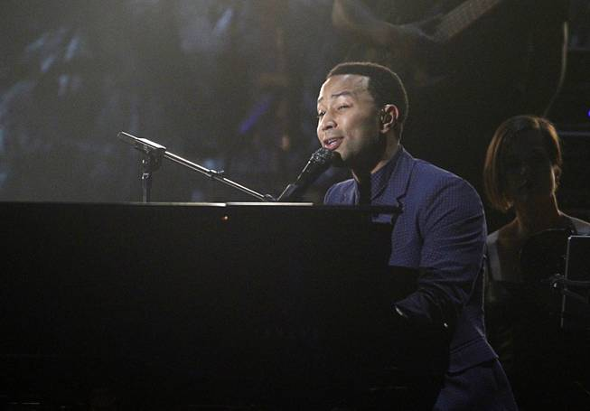 John Legend performs on piano during the 2014 Billboard Music Awards at the MGM Grand Garden Arena Sunday, May 18, 2014.
