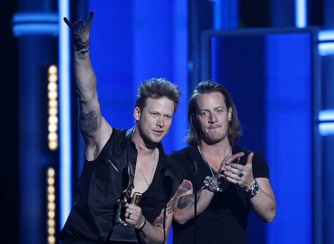 "Brian Kelley, left, and Tyler Hubbard of Florida Georgia Line accept the Top Country Song for ""Cruise"" during the 2014 Billboard Music Awards at the MGM Grand Garden Arena Sunday, May 18, 2014."