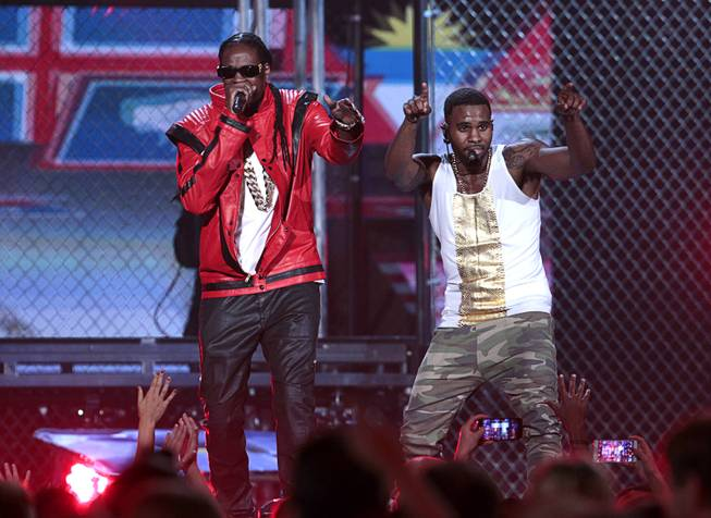 Rapper 2 Chainz, left, and singer Jason Derulo perform during the 2014 Billboard Music Awards at the MGM Grand Garden Arena Sunday, May 18, 2014.