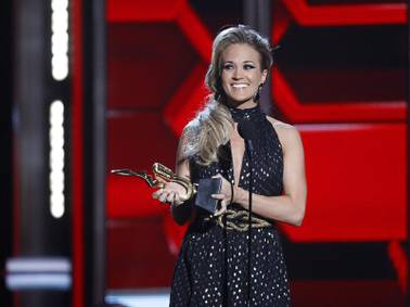 Carrie Underwood accepts the Milestone Award during the 2014 Billboard Music Awards at the MGM Grand Garden Arena Sunday, May 18, 2014.