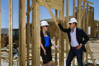 Daniel Grimm and Alison Burk talk about their construction site at Somerset Hills, a 20-acre 360-unit complex in southwest Las Vegas on Friday, May 9, 2014.  Grimm is president and CEO of Development Corporation and Burk development director with the Fore Property Company.